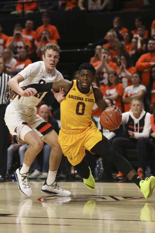 Arizona State's Luguentz Dort (0) drives to the basket, past Oregon State's Kylor Kelley (24) during the first half of an NCAA college basketball game in Corvallis, Ore., Sunday, March 3, 2019. (AP Photo/Amanda Loman)