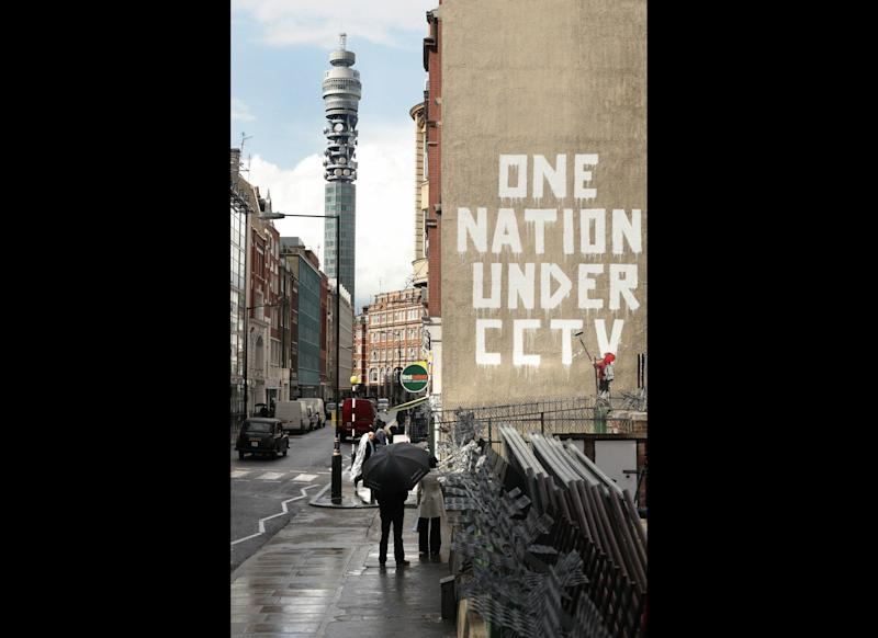 A work of art believed to be by British artist Banksy is pictured in Central London, on April 14, 2008. AFP PHOTO/Shaun Curry (Photo credit should read SHAUN CURRY/AFP/Getty Images)
