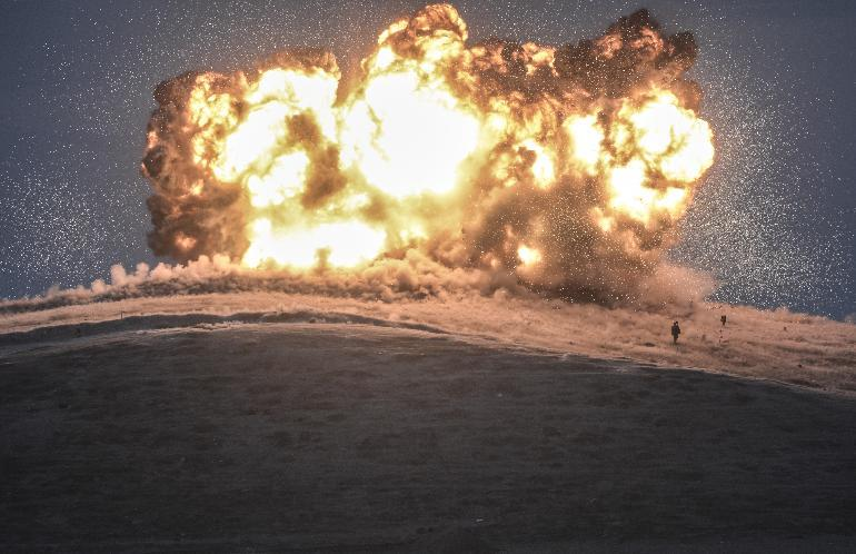 Militants of Islamic State (IS) stand just before explosion of an air strike on Tilsehir hill near Turkish border, at Yumurtalik village, in Sanliurfa province, October 23, 2014