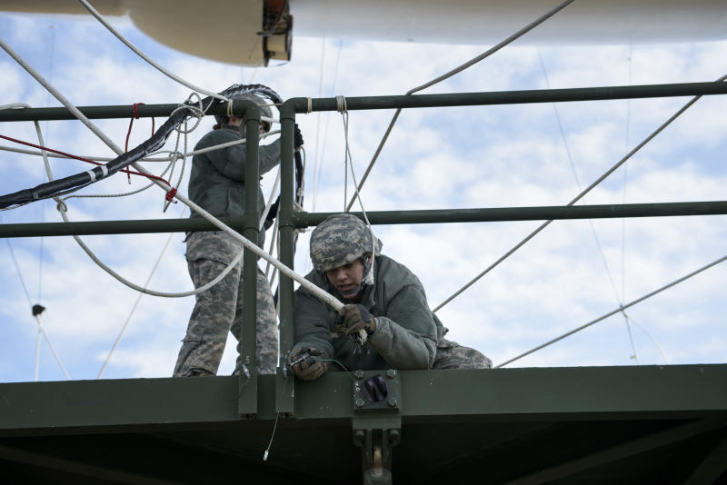 Soldiers secure a line while mooring an aerostat to its mobile mooring station at the Aberdeen Proving Ground in Maryland (AFP Photo/Brendan Smialowski)