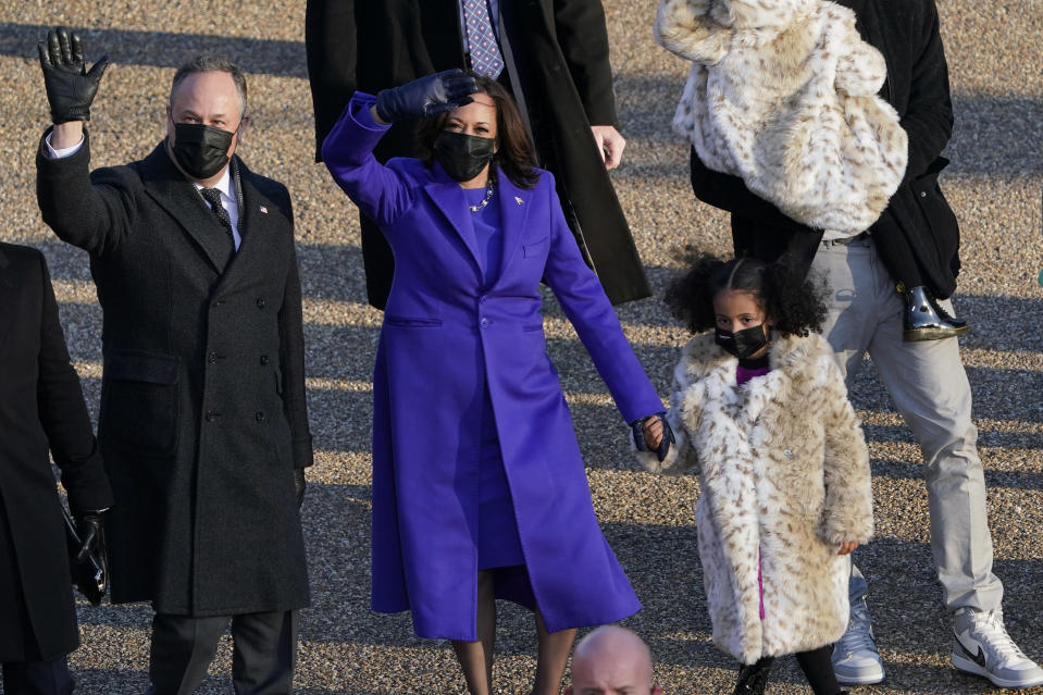 Vice President Kamala Harris and her husband Doug Emhoff walk in the parade during the Presidential Escort, part of Inauguration Day ceremonies, Wednesday, Jan. 20, 2021, in Washington. (AP Photo/David J. Phillip)