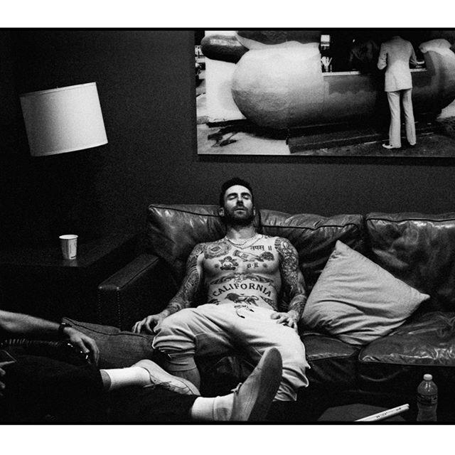 """<p>Nap time or tat time? The word """"California,"""" a sanskrit symbol, a lion, and an angel are all displayed in this photo of Adam """"embracing the chaos.""""</p><p><a rel=""""nofollow"""" href=""""https://www.instagram.com/p/Bj-bxgCFeLx/"""">See the original post on Instagram</a></p>"""