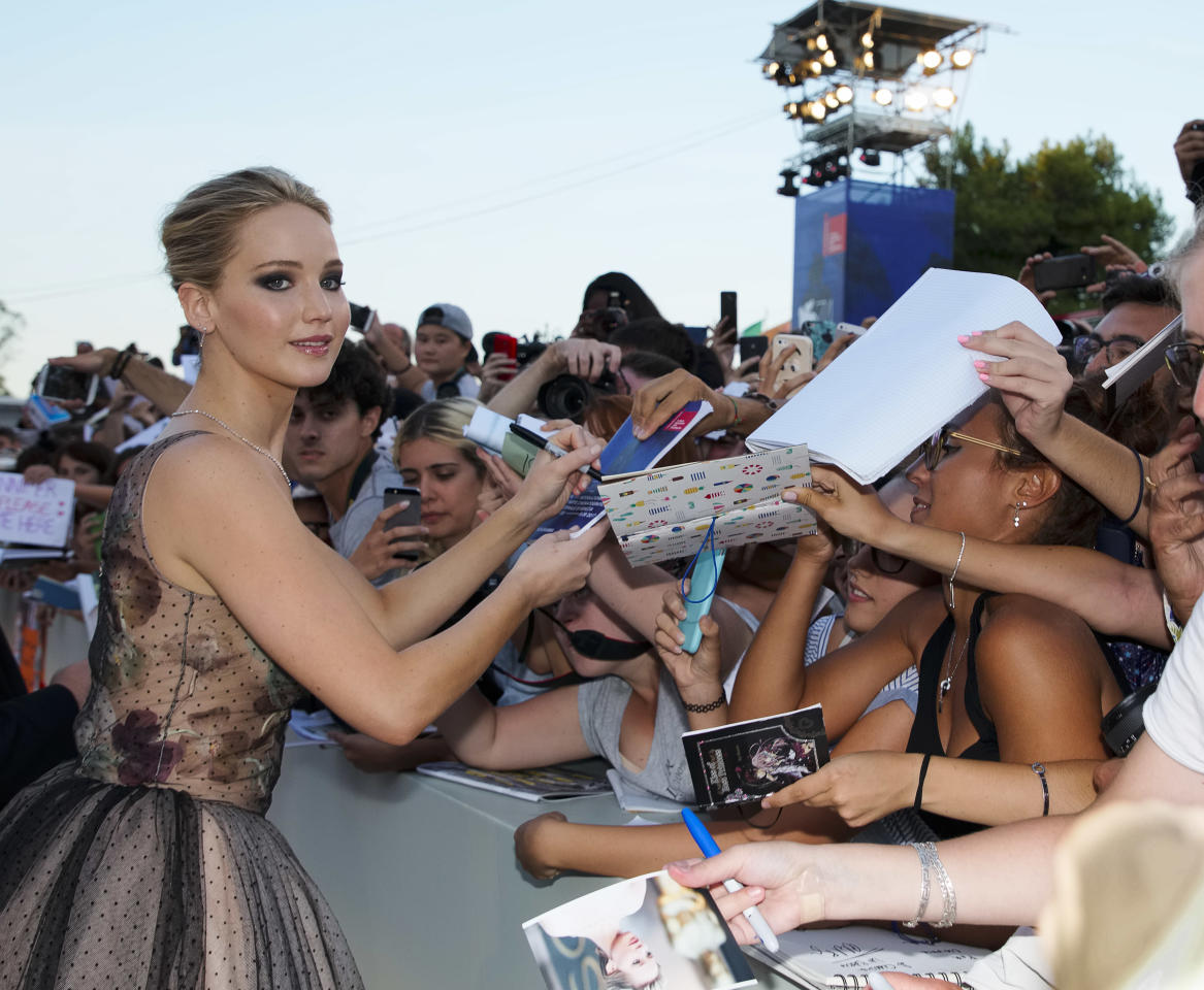 "FILE--In this Sept. 5, 2017, file photo, actress Jennifer Lawrence signs autographs at the premiere of the film ""mother!"" at the 74th edition of the Venice Film Festival in Venice, Italy. Harvey Weinstein has asked a judge to toss out a federal sexual misconduct lawsuit filed against him and he's invoking the words of Lawrence and other A-list actresses in his defense. (AP Photo/Domenico Stinellis)"