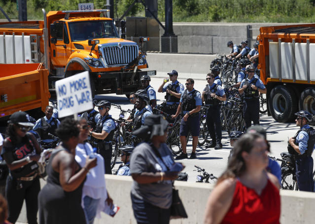 <p>Chicago Police officers monitor the scene as activists march onto Chicago Dan Ryan Expressway to protest violence in the city on July 7, 2018 in Chicago, Ill. (Photo: Kamil Krzaczynski/Getty Images) </p>