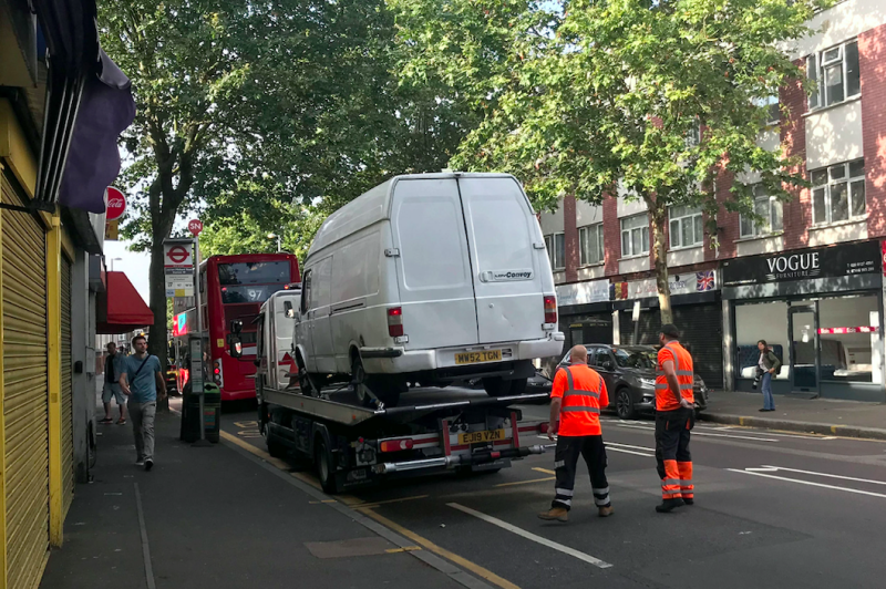 A van, believed to have been driven by the attacker, is loaded at the scene in Leyton this morning (PA)