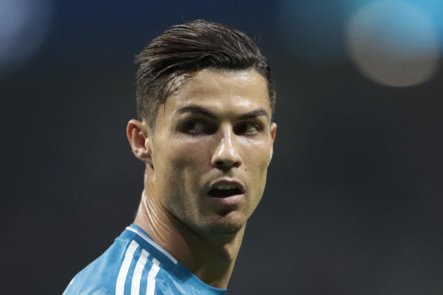 Juventus' Cristiano Ronaldo looks back during the Champions League Group D soccer match between Atletico Madrid and Juventus at the Wanda Metropolitano stadium in Madrid, Spain, Wednesday, Sept. 18, 2019. (AP Photo/Bernat Armangue)