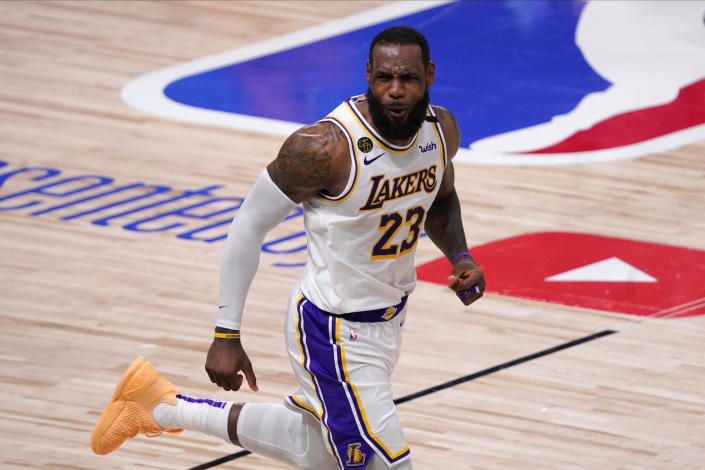 Los Angeles Lakers' LeBron James (23) celebrates during the second half in Game 6 of basketball's NBA Finals against Miami Heat Sunday, Oct. 11, 2020, in Lake Buena Vista, Fla. The Lakers defeated the Miami Heat 106-93. (AP Photo/Mark J. Terrill)