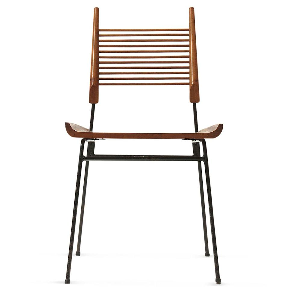 """<p>This maple-and-iron piece is like a more refined school chair. I have a few in my dining room and even designed a white lacquered wood table to go with them.</p><p><a class=""""link rapid-noclick-resp"""" href=""""https://go.redirectingat.com?id=74968X1596630&url=https%3A%2F%2Fwww.1stdibs.com%2Ffurniture%2Fseating%2Fside-chairs%2Fpaul-mccobb-maple-iron-shovel-chair-newly-refinished%2Fid-f_23382112%2F&sref=https%3A%2F%2Fwww.elledecor.com%2Fshopping%2Fg37145862%2Fprabal-gurung-favorite-things%2F"""" rel=""""nofollow noopener"""" target=""""_blank"""" data-ylk=""""slk:Buy Now"""">Buy Now</a></p>"""