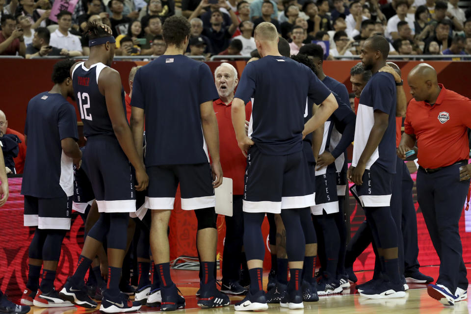 FILE - In this Sept. 1, 2019, file photo, U.S. coach Gregg Popovich talks to players before a Group E match against the Czech Republic in the FIBA basketball World Cup in Shanghai. Kevin Durant and coach Popovich will lead the U.S. team into the Tokyo Olympics as the Americans try to secure a fourth consecutive gold medal. (AP Photo/Ng Han Guan, File)