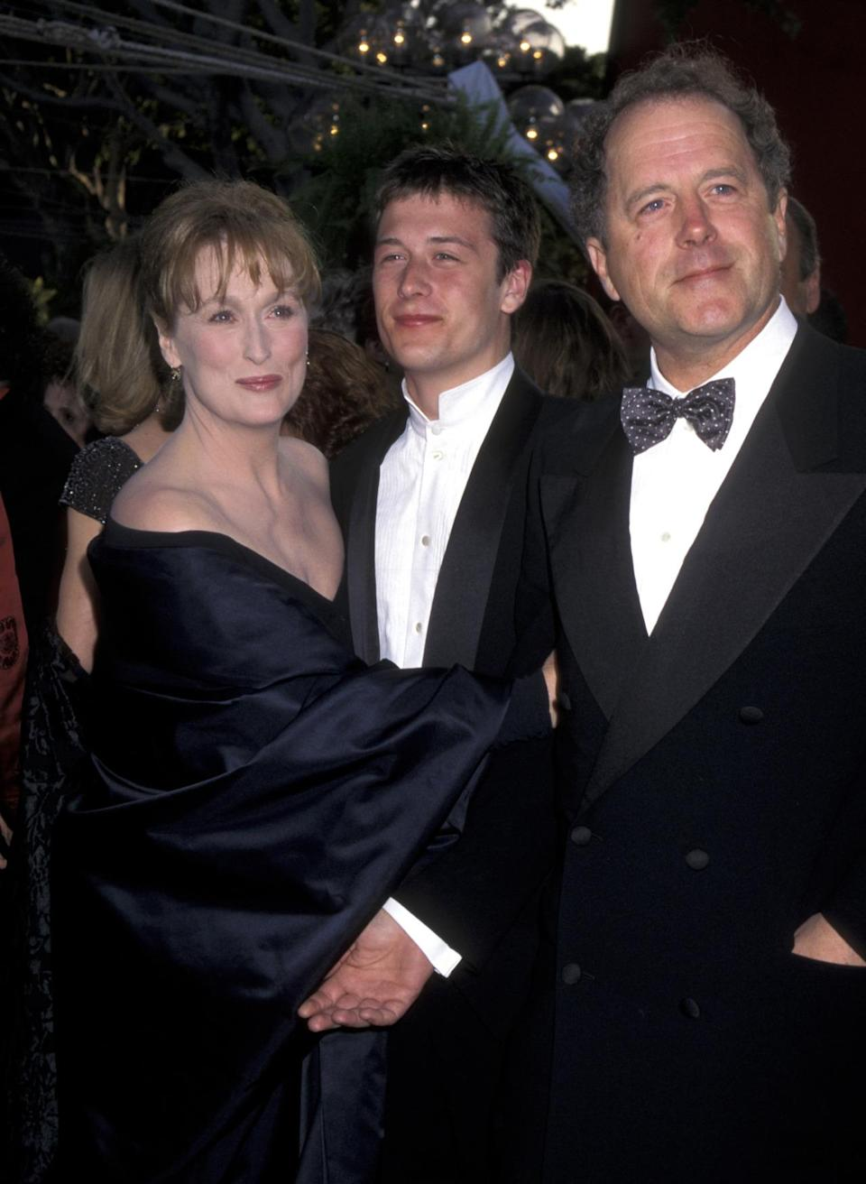 """<p>Huddled with her husband, Don Gummer and their son Henry, Streep wore a Donna Karan dress when she was nominated for <a rel=""""nofollow noopener"""" href=""""http://www.imdb.com/title/tt0112579/?ref_=nmawd_awd_10"""" target=""""_blank"""" data-ylk=""""slk:The Bridges of Madison County."""" class=""""link rapid-noclick-resp""""><i>The Bridges of Madison County.</i></a></p>"""
