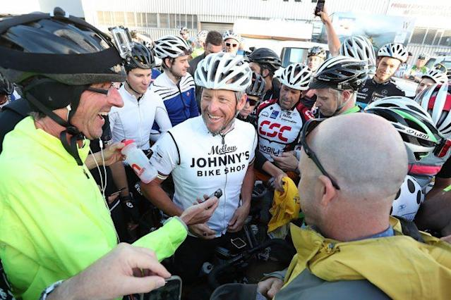 Armstrong chats with fellow cyclists in Auckland, New Zealand, late last year. (Fiona Goodall/Getty Images)