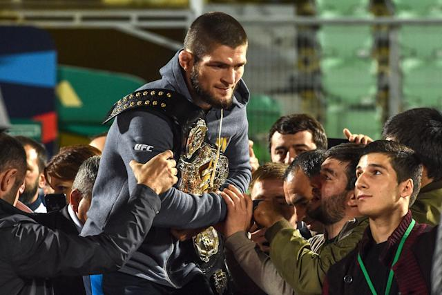 KhabibNurmagomedov received a hero's welcome at home in a stadium packed with thousands of fans celebrating his championship. (Getty)