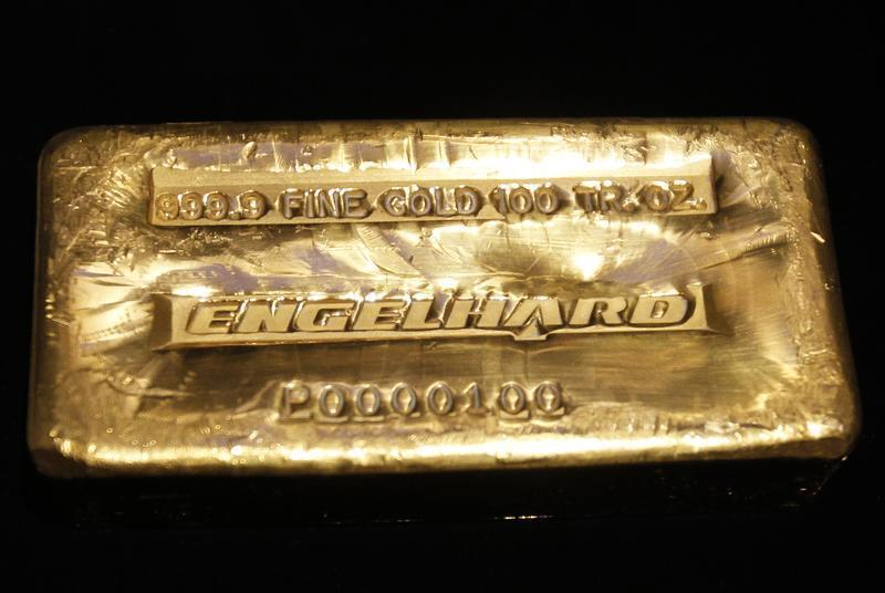 A 999.9 fine gold 100 troy ounce Engelhard gold bar is seen on the floor of the New York Stock Exchange in New York