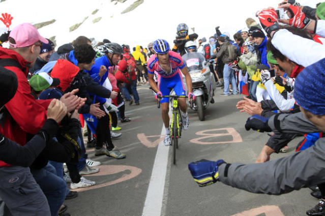 Italian cyclist Michele Scarponi rides on Passo dello Stelvio uphill during the Tour of Italy cycling race Giro's 20th stage, a 219km ride from Caldes Val di Sole to Passo dello Stelvio, on May 26, 2012 in Passo dello Stelvio. AFP PHOTO/ POOL/ LUCA BETTINILUCA BETTINI/AFP/GettyImages