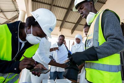 Distribution of personal protective gear in Mozambique. Photo credit: Denis Onyodi