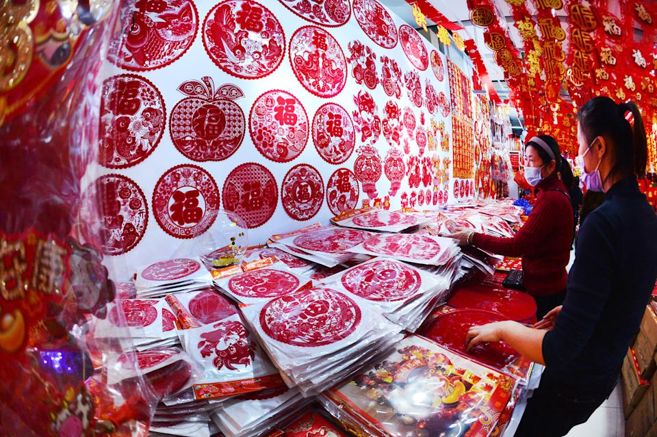 SHENYANG, CHINA - DECEMBER 20, 2020 - People buy ornaments for the Year of the Ox in The Lunar calendar to welcome the New Year in Shenyang, Liaoning province, Dec. 20, 2020.- PHOTOGRAPH BY Costfoto / Barcroft Studios / Future Publishing (Photo credit should read Costfoto/Barcroft Media via Getty Images)