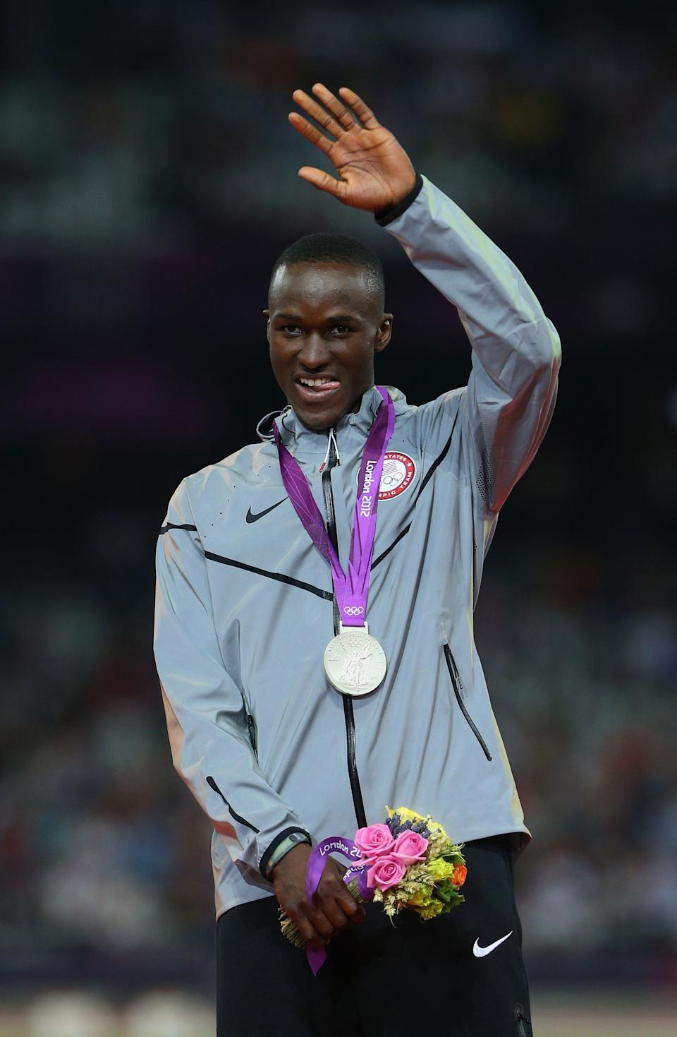 """Silver medalist <a href=""""http://sports.yahoo.com/olympics/track-field/will-claye-1135588/"""" data-ylk=""""slk:Will Claye"""" class=""""link rapid-noclick-resp"""">Will Claye</a> of the United States celebrates on the podium during the medal ceremony for the Men's Triple Jump on Day 13 of the London 2012 Olympic Games at Olympic Stadium on August 9, 2012 in London, England. (Getty Images)"""