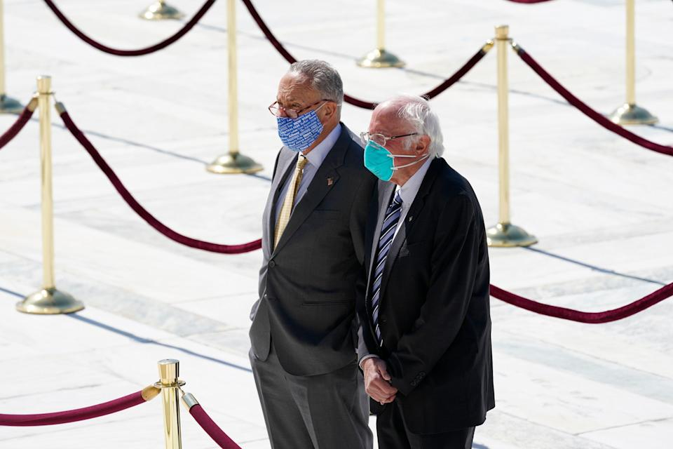 Sens. Chuck Schumer and Bernie Sanders pay their respects as the late Justice Ruth Bader Ginsburg lies in repose at the U.S. Supreme Court on Sept. 23, 2020. (AP Photo/Alex Brandon)