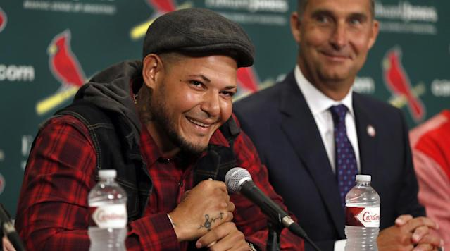The St. Louis Cardinals and catcher Yadier Molina have agreed to a three-year contract extension worth $60 million.
