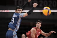 Matthew Anderson, of the United States, spikes a ball past Argentina's Ezequiel Palacios, during a men's volleyball preliminary round pool B match, at the 2020 Summer Olympics, early Monday, Aug. 2, 2021, in Tokyo, Japan. (AP Photo/Manu Fernandez)