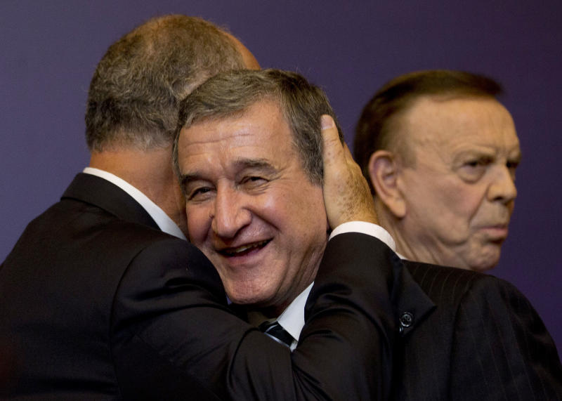 Brazil's soccer coach Luiz Felipe Scolari is embraced by former coach Carlos Alberto Parreira during a press conference presenting Scolari as Brazil's new coach, in Rio de Janeiro, Brazil, Thursday, Nov. 29, 2012. Scolari is returning to the national team 10 years after leading the country to the 2002 World Cup title. (AP Photo/Silvia Izquierdo)