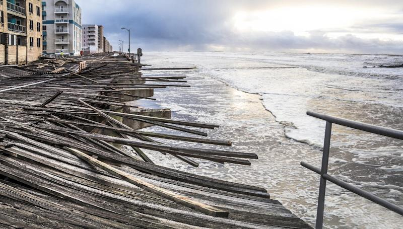 "In this Oct. 30, 2012 photo provided by the photographer, waves crash onto the battered boardwalk in Long Beach, N.Y., the morning after Superstorm Sandy struck.Tisi-Kramer's Long Island photo is one of 200 images of Sandy at an exhibition at the Museum of the City of New York. ""Rising Waters: Photographs of Sandy,"" opens Oct. 29 on the one-year anniversary of the storm. (AP Photo/Tisi-Kramer)"