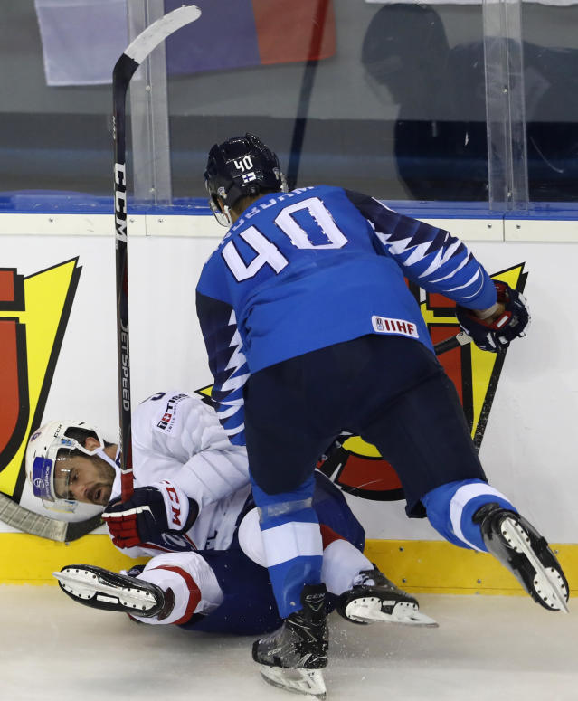 Finland's Petteri Lindbohm, right, checks Damien Fleury of France, left, during the Ice Hockey World Championships group A match between France and Finland at the Steel Arena in Kosice, Slovakia, Sunday, May 19, 2019. (AP Photo/Petr David Josek)