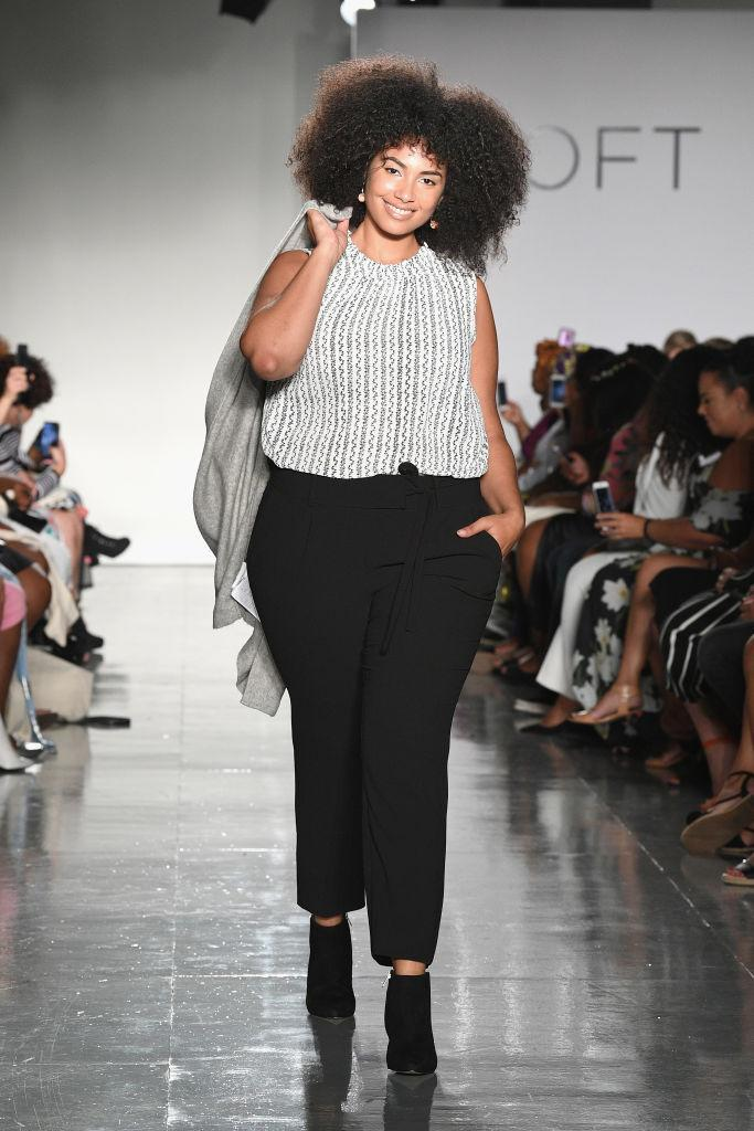 <p>A curvy model walks Loft's show wearing a sleeveless top and black trousers at theCURVYcon during New York Fashion Week. (Photo: Getty Images) </p>