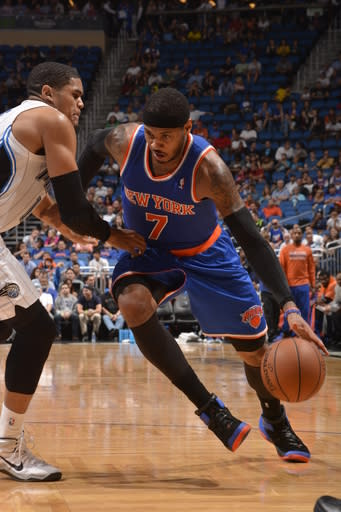 ORLANDO, FL - DECEMBER 23: Carmelo Anthony #7 of the New York Knicks drives to the basket against the Orlando Magic during the game on December 23, 2013 at Amway Center in Orlando, Florida. (Photo by Fernando Medina/NBAE via Getty Images)