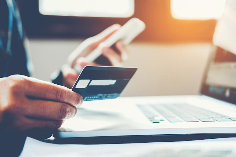 A customer prepares to pay for an online purchase with a credit card.