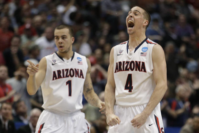 Arizona guard Gabe York (1) and Arizona guard T.J. McConnell (4) cheer during the second half in a regional semifinal NCAA college basketball tournament game against San Diego State, Thursday, March 27, 2014, in Anaheim, Calif. (AP Photo/Jae C. Hong)