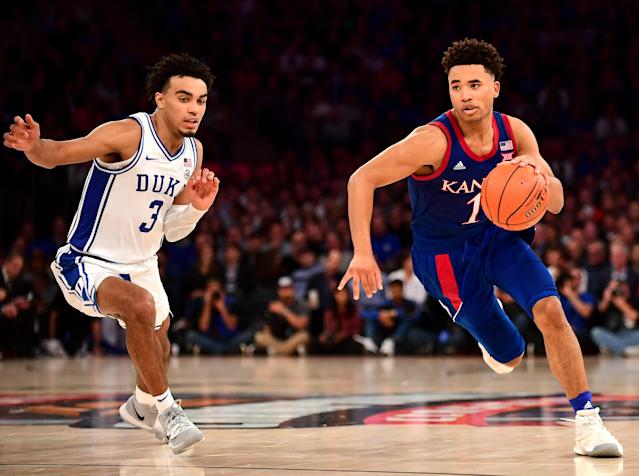 Devon Dotson of Kansas dribbles the ball down the court while being guarded by Duke's Tre Jones during a game on Nov. 5, 2019, in New York. (Emilee Chinn/Getty Images)