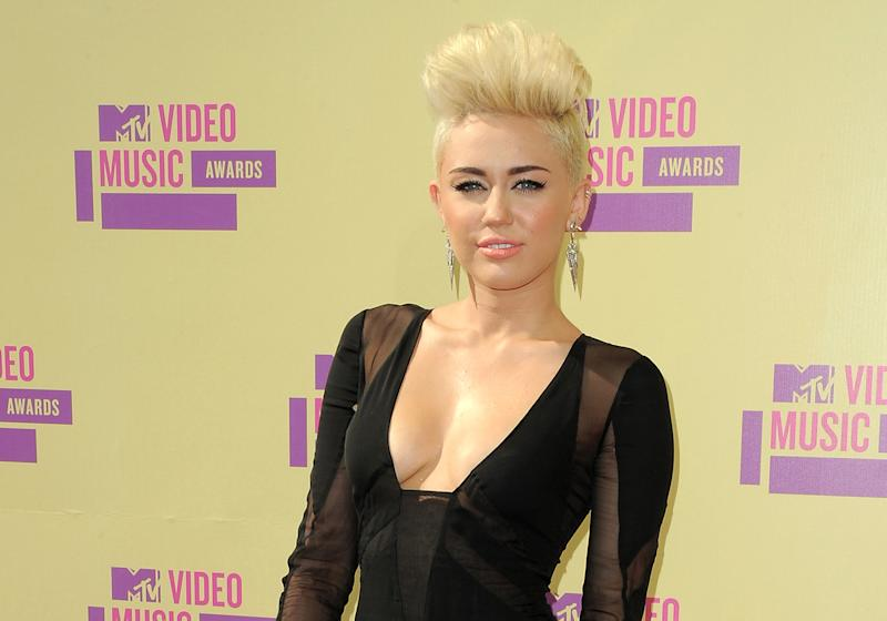 FILE - In this Sept. 6, 2012 file photo, Miley Cyrus attends the MTV Video Music Awards in Los Angeles. A Los Angeles jury convicted Jason Luis Rivera, 40, of trespassing and resisting arrest on Thursday Oct. 11, 2012, roughly a month after he was arrested at the singer's home. (Photo by Jordan Strauss/Invision/AP, file)