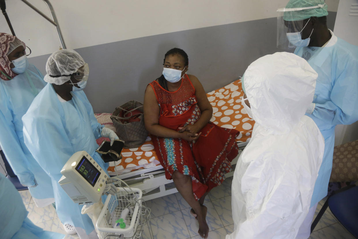 A COVID-19 patient speaks to medical staff, at the Farcha provincial hospital in N'Djamena, Chad, Friday April 30, 2021.  While the world's wealthier nations have stockpiled coronavirus vaccines for their citizens, many poorer countries are scrambling to secure enough doses, and some, like Chad, have yet to receive any.  (AP Photo/Sunday Alamba)