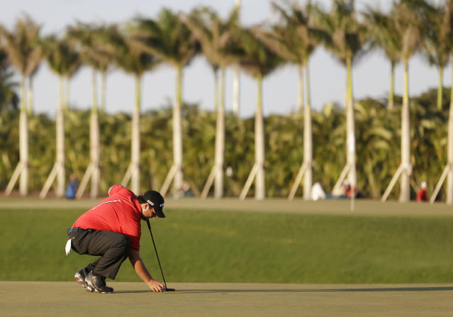 Patrick Reed sets up his final putt before winning the Cadillac Championship golf tournament Sunday, March 9, 2014, in Doral, Fla. (AP Photo/Wilfredo Lee)