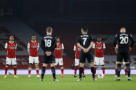 Arsenal and Aston Villa players observe a moment's silence for Remembrance Sunday before the English Premier League soccer match between Arsenal and Aston Villa at the Emirates stadium in London, Sunday, Nov. 8, 2020. (Richard Heathcote/Pool via AP)