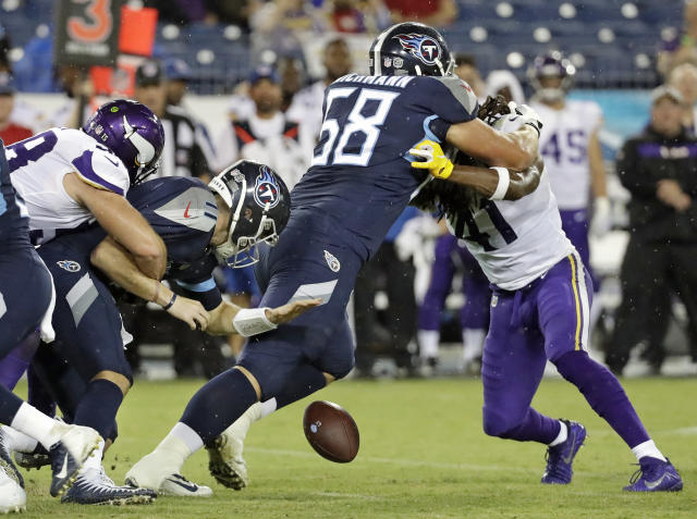 Tennessee Titans quarterback Luke Falk (11) fumbles the ball as he is hit by Minnesota Vikings linebacker Garret Dooley, left, in the first half of a preseason NFL football game Thursday, Aug. 30, 2018, in Nashville, Tenn. The Titans recovered the ball on the play. Titans offensive guard Cody Wichmann (68) blocks Vikings safety Anthony Harris (41). (AP Photo/James Kenney)