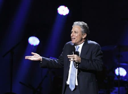 "Comedian Jon Stewart speaks during the ""12-12-12"" benefit concert for victims of Superstorm Sandy at Madison Square Garden in New York in this file photo"