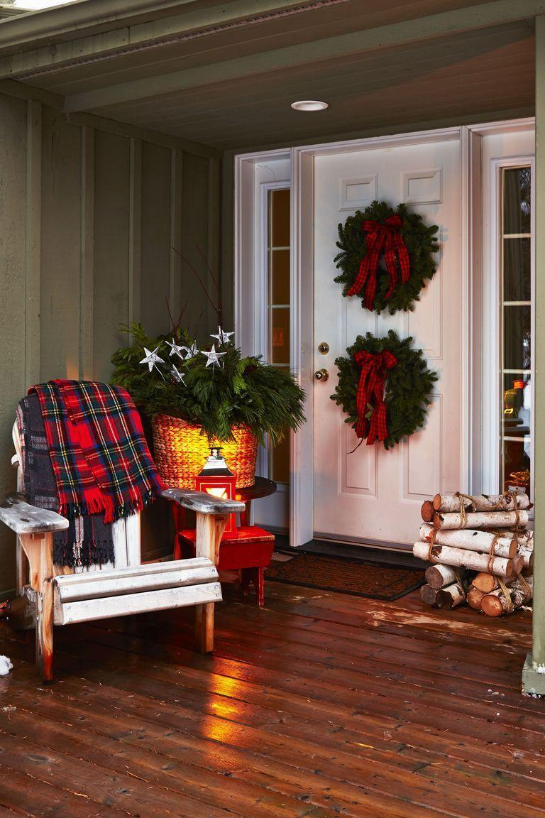 <p>More is more, especially when it comes to the holiday season. Stack two wreaths of your choice—using a fishing line to keep them in place—then spruce them up with plaid bows for a dose of cheer. </p>