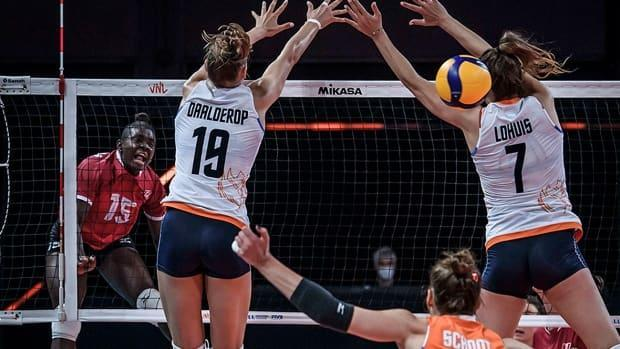 Canada opposite hitter Shainah Joseph, left, spikes the ball past Nika Daalderop and middle blocker Juliet Lohuis of the Netherlands during Volleyball Nations League action on Tuesday in Rimini, Italy. Canada was swept 3-0 in sets and saw its record slip to 2-7. (volleyballworld.com - image credit)