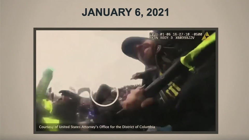 Footage from an officer's body camera taken during the Jan. 6 attack on the Capitol is shown during former President Donald Trump's impeachment trial Wednesday. (Screengrab via Reuters TV)