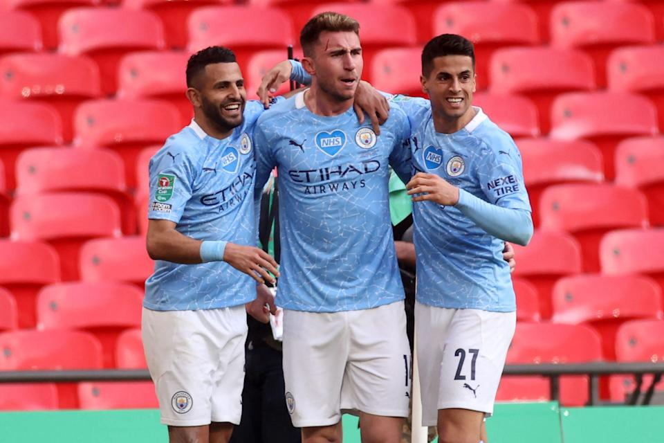 Manchester City's Aymeric Laporte (center) celebrates scoring in his team's 1-0 win over Tottenham in the English League Cup final at Wembley Stadium on Sunday.
