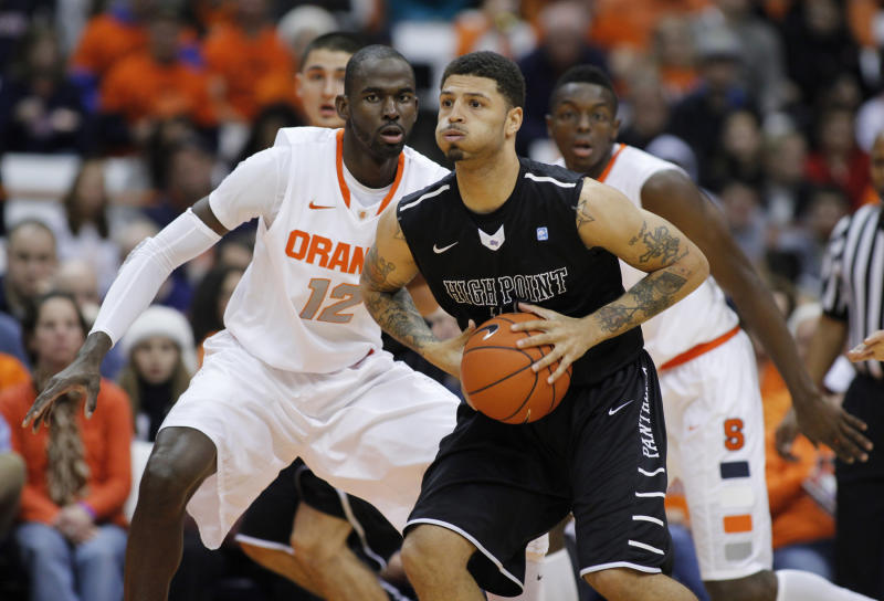High Point's Tarique Thompson, front, looks to pass the ball against Syracuse's Baye Moussa Keita, left, and Jerami Grant, right, in the first half of an NCAA college basketball game in Syracuse, N.Y., Friday, Dec. 20, 2013. (AP Photo/Nick Lisi)