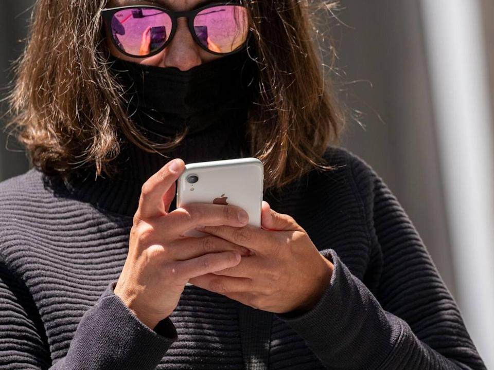 Although it won't sell as many as it thought it would in the fourth quarter, Apple is still on track to sell 250 million iPhones next year, analysts say. (David Paul Morris/Bloomberg - image credit)