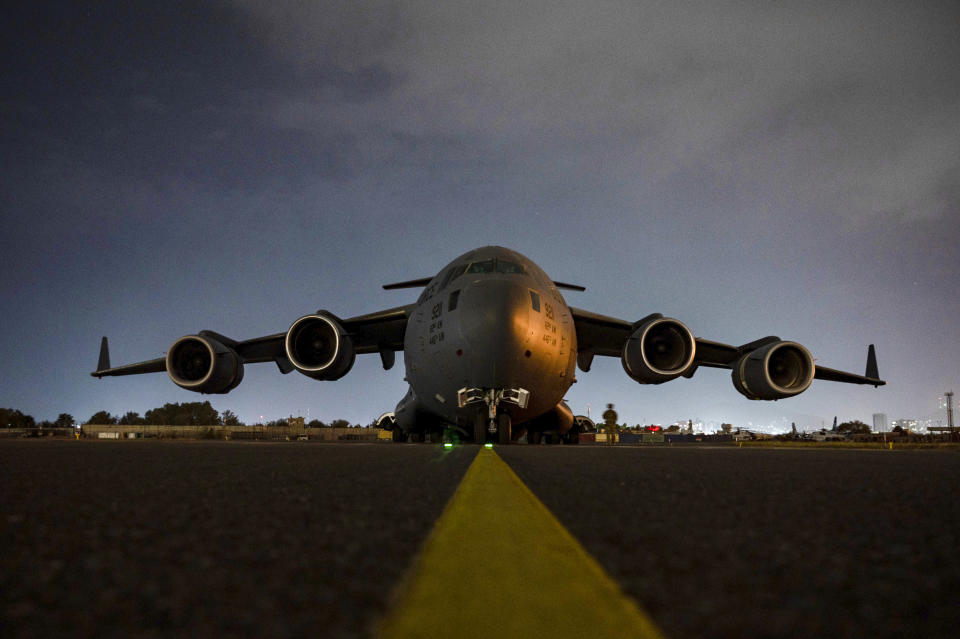 In this Aug. 30, 2021, photo provided by the U.S. Air Force, a Air Force C-17 Globemaster III aircrew, assigned to the 816th Expeditionary Airlift Squadron, prepares to receive soldiers, assigned to the 82nd Airborne Division, to board at Hamid Karzai International Airport in Kabul, Afghanistan. (Senior Airman Taylor Crul/U.S. Air Force via AP)