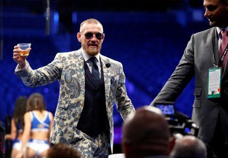UFC lightweight champion Conor McGregor of Ireland leaves post-fight news conference at T-Mobile Arena in Las Vegas