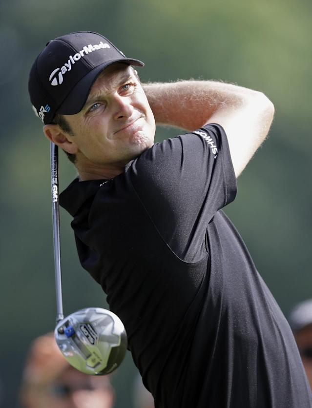 Justin Rose, from England, watches his tee shot on the 11th hole during the second round of the Bridgestone Invitational golf tournament Friday, Aug. 1, 2014, at Firestone Country Club in Akron, Ohio. (AP Photo/Mark Duncan)