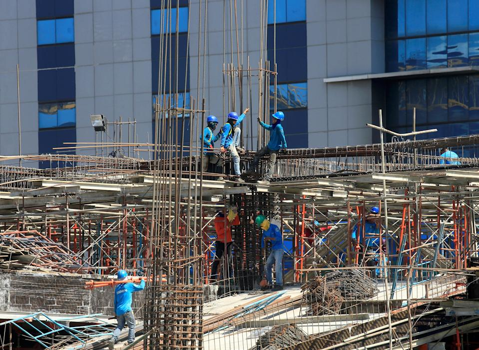 Workers install steel rods at a construction site in Paranaque City, Metro Manila, Philippines. (Photo: REUTERS/Romeo Ranoco)