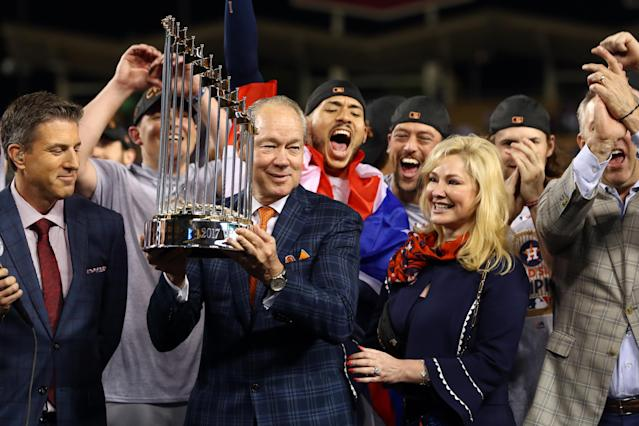 Astros owner Jim Crane hoists the 2017 World Series trophy. (Photo by Alex Trautwig/MLB via Getty Images)