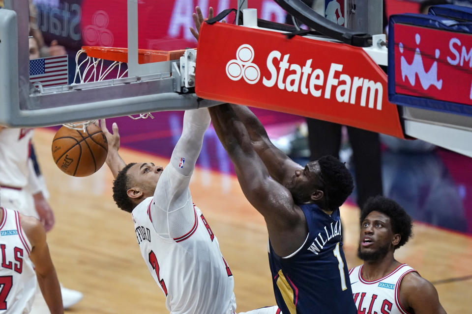 New Orleans Pelicans forward Zion Williamson (1) dunks against Chicago Bulls center Daniel Gafford during the first half of an NBA basketball game in New Orleans, Wednesday, March 3, 2021. (AP Photo/Gerald Herbert)